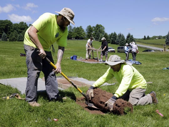 Jesse Pagels, left, and Edgar Alarcon, of the Public Archaeology Facility at Binghamton University, start a new dig at the site of the original Woodstock Music and Art Fair, in Bethel on June 14.