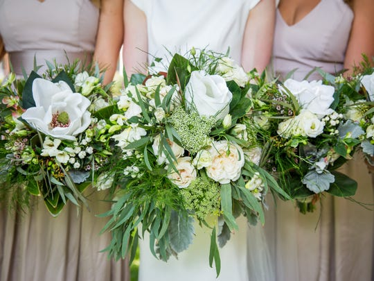 The bride's bouquet of fresh flowers included roses,