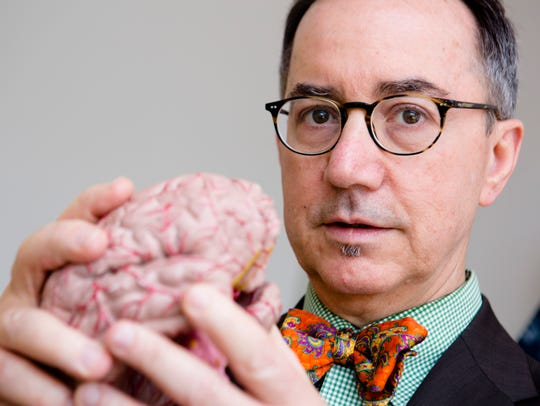 Dr. Michael Privitera holds his human brain replica