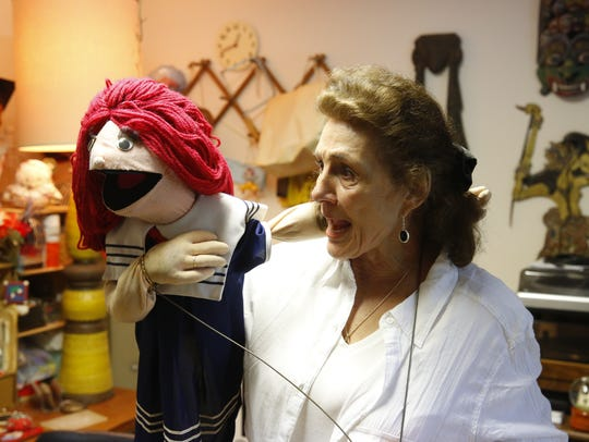 Jan Kaufman showcases one of her many puppets. Jan