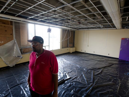 Damon Lynch IV, director of sustainability at New Prospect Baptist Church, shows spaces that are being renovated in the ground floor of the 90,000 square-foot building that once housed the Jewish Community Center.
