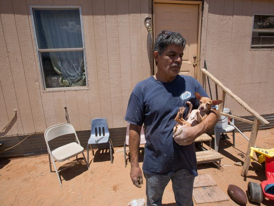 Gerardo Barragan on Wednesday June 27, 2018, stands outside his brother's home, which is next to his mobile home that was destroyed by a fire Tuesday. Barragan lived alone in the mobile home with his pet dog and parrot. The parrot was killed in the fire.