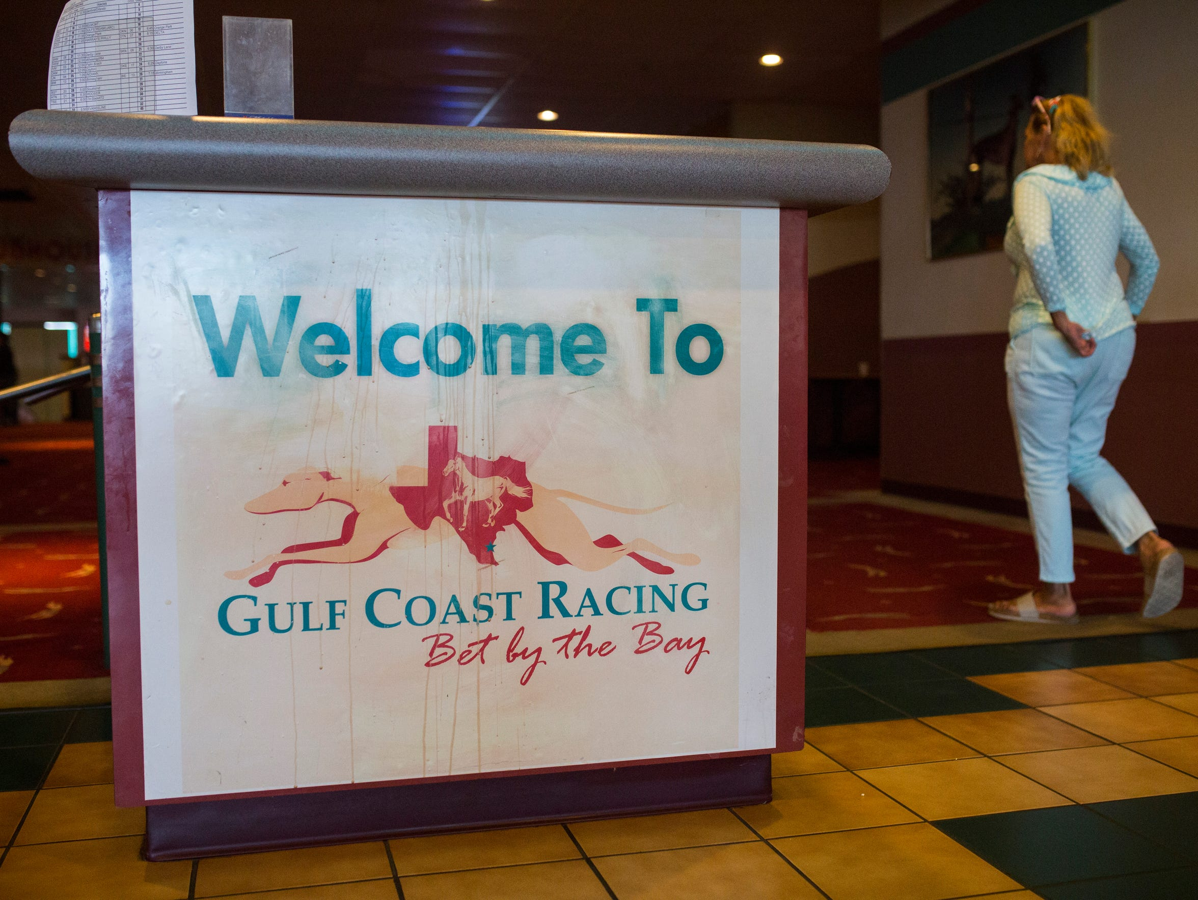People bet on races at the Gulf Coast Racing center