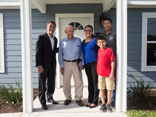 Pastor Steve Coronado Jr. (from the left), Eugene Bouligny, Bijanka Castillo, city council member Ben Molina, and Roel Galvan, 10, pose in front of the Castillo's new home during Habitat for Humanity dedication ceremony on Friday, June 29, 2018, on Guadalupe Street.