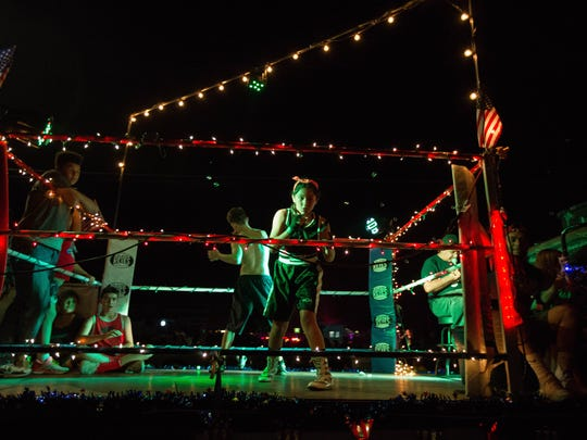 The Las Cruces PAL Boxing Sammy Burke Youth Boxing Center Float drives down East Madrid, Tuesday July 3, 2018 during the 2018 Electric.Light Parade.