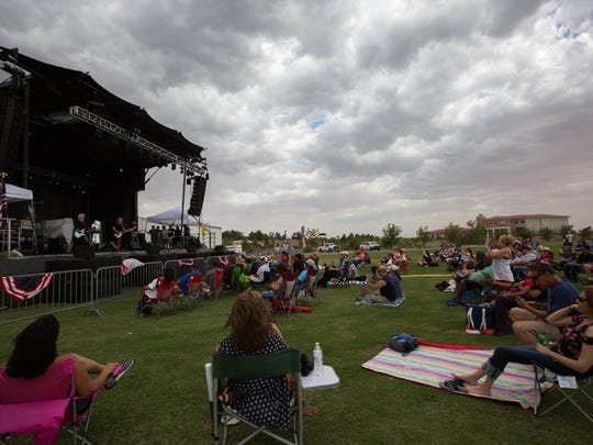 Clouds and gusts of wind mark the start of the Las Cruces Fourth of July Celebration at the Sisbarro Community Park at New Mexico State University on Wednesday July 4, 2018.