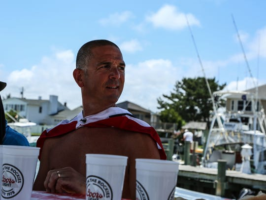 """Fish Tales in Ocean City had its 11th Hot Dog Easing Contest on July 4, 2018.  The owner Shawn Harman said, """"It was just the American thing to do.""""  It was attended by over 300 people."""