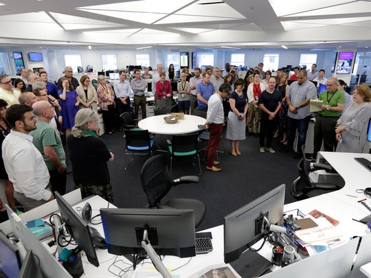 Employees gather in the newsroom of the New York headquarters of The Associated Press on July 5, 2018, for a moment of silence for the five employees of the Capital Gazette, a Maryland newspaper, who were killed a week ago in one of the deadliest attacks on journalists in U.S. history.