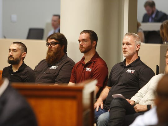 Proof Brewing Company founder Byron Burroughs, right, and members of his team sit in at a Community Redevelopment  Association meeting on Monday. Proof Brewing was denied $450,000 in CRA funds that were to be utilized for a new plant in the building that formally housed a Coke factory on South Monroe Street.