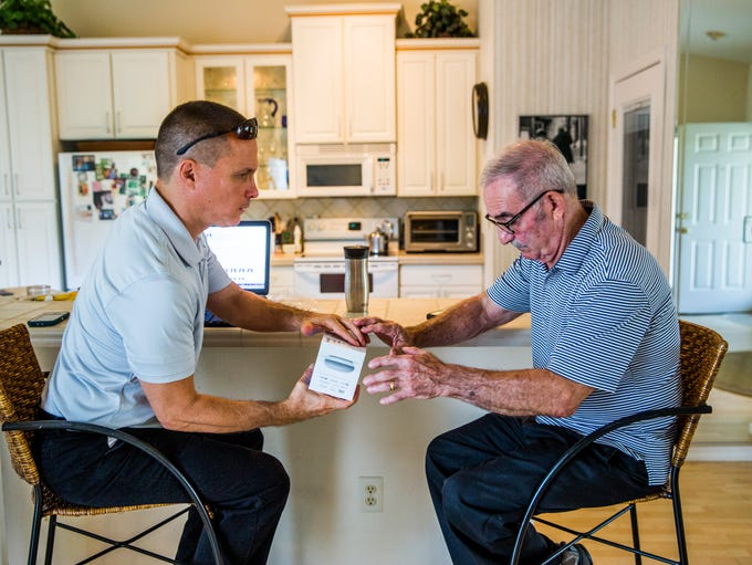 Rich Naccarato, 69, right, sets up his new Google Home