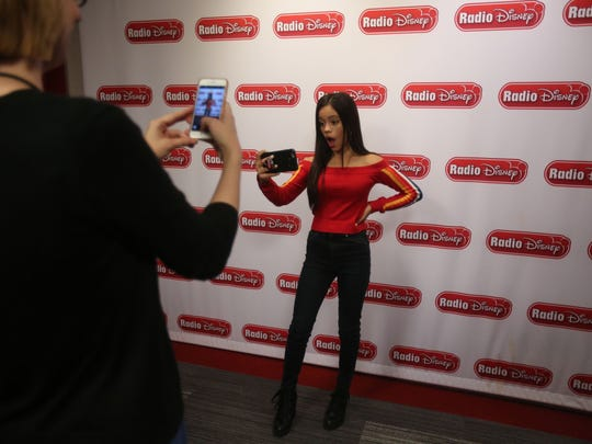 Actress Jenna Ortega snaps photos for social media after a recording session at the Radio Disney studio in Burbank, CA.