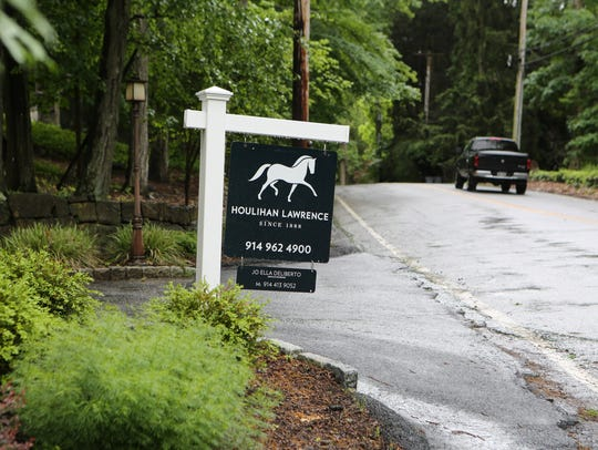 A home for sale sign along Washington Street in Cortlandt,