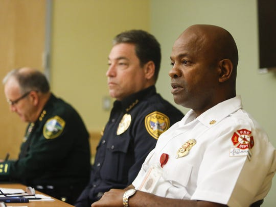 Tallahassee Fire Department Chief Jerome Gaines, right,