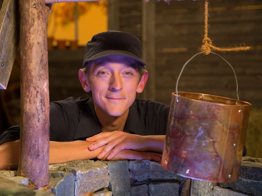 "Mister Chris, played by Chris Dorman, sits beside the wishing well found on ""Mister Chris and Friends,"" the children's show he hosts on Vermont PBS."