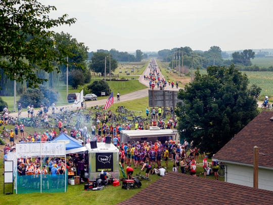 The Iowa craft beer tent in Soldier has a line during the first day of RAGBRAI Sunday, July 22, 2018.