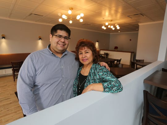 "Tyrone Azanedo with his mother at their restaurant, Maura's Kitchen in Nyack.  ""This is my mom's and my only income,"" he said. ""I also worry about our staff. """