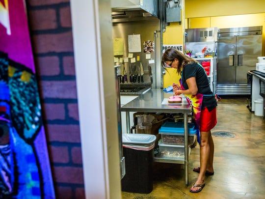 Owner of Smilin' Dog Bakery Teresa Hoover works on