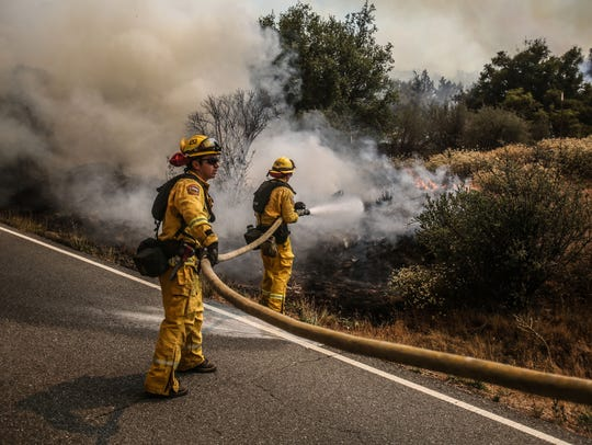 Fire fighters knock down hot spots along HWY 74 on