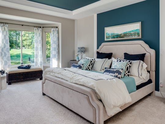 Greys and blues are popular choices for wall colors today, complemented by white accents and darker wood choices.
