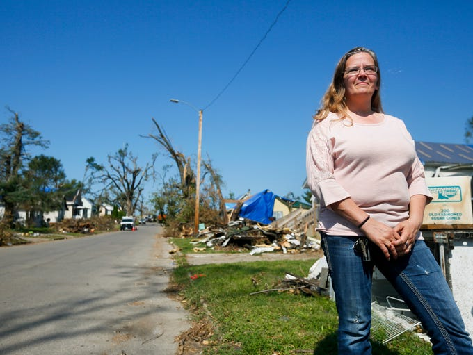 Pamela Fricke stands in front of her home on Bromley
