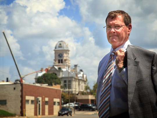 Marshalltown Mayor Joel Greer stands for a photo with the city's iconic courthouse that was badly damaged after an EF-3 tornado struck on July 19.