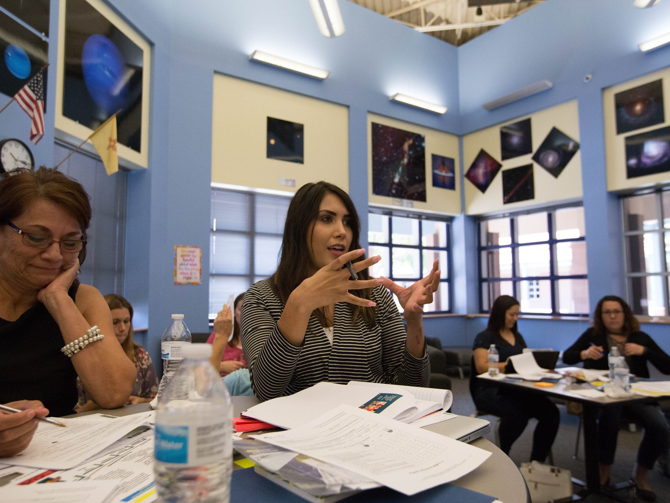 Amy Lerma, center,  a Head Start teacher, asks questions about New Mexico teacher evaluations during a training given by the University of New Mexico's Center for Development and Disability, Thursday, August 2, 2018. Both Head Start and PreK teachers attended the training.