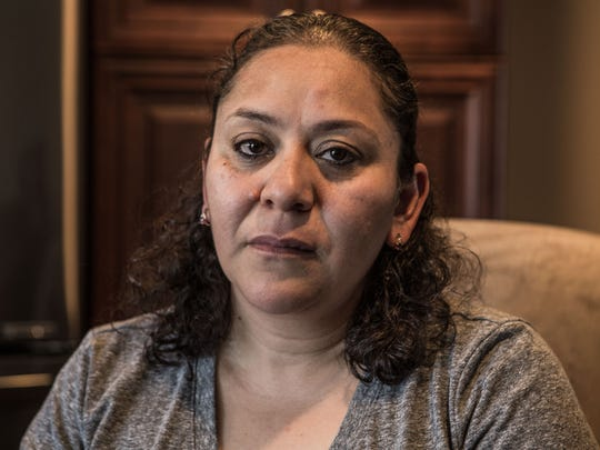 Sitting in her new home, Leticia Guzman, 41, tearfully recalls losing her home in the October 2017 wildfire that swept through the Coffey Park area of Santa Rosa.