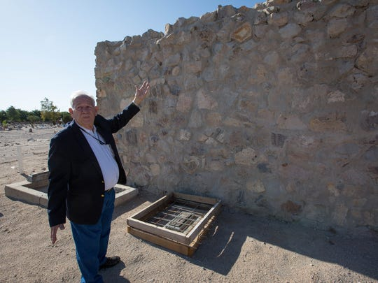 Martin Amador Campbell explains where part of the Amador Family Mausoleum was damaged and now repaired, Monday August 6, 2018. Campbell and other members of the Amador Family gathered for a blessing by Bishop Oscar Cantu.