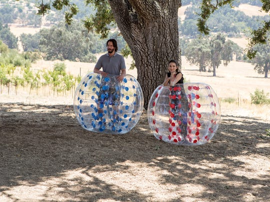 """In """"Destination Wedding,"""" Frank (Keanu Reeves) and Lindsay (Winona Ryder) wind up spending a lot of time together during a wedding weekend."""