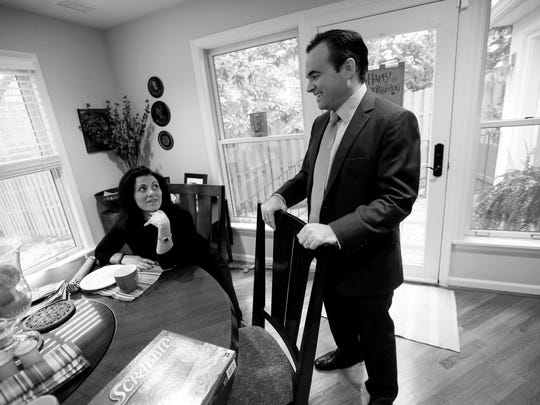 John Cranley talks to his wife, Dena, before leaving