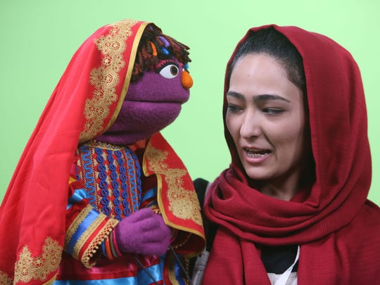 In this Wednesday, April 6, 2016 photo, Afghan puppeteer Mansoora Shirzad, right, records a segment with Sesame Street's new character, a 6-year-old Afghan girl called Zari.