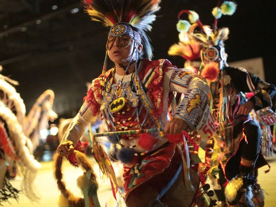 Native Americans participate in the grand entry at