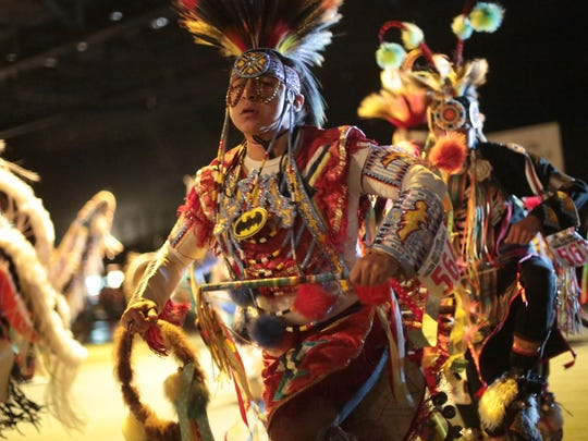 Native Americans participate in the grand entry at the 33rd Indio Powwow hosted by the Cabazon Band of Mission Indians on Saturday, November 29, 2014 at the Fantasy Springs Special Events Center in Indio.