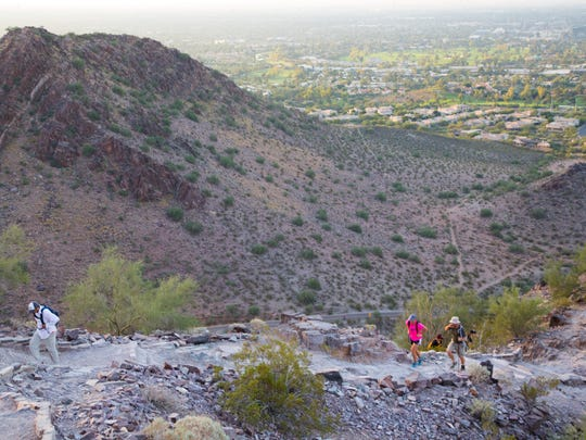 Hikers make their way up Piestewa Peak as they try and complete the Seven Summit Challenge in Phoenix on Nov. 15, 2014. The challenge has the hikers climb seven peaks in 11 hours.