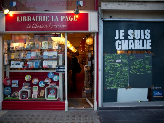 "A French bookshop, where staff expect to get copies of  the latest edition of French satirical magazine Charlie Hebdo in stock to go on sale on Friday, is seen with a large ""I am Charlie"" sign next to the entrance in London, Wednesday, Jan. 14, 2015.  Charlie Hebdo's defiant new issue sold out before dawn around Paris on Wednesday, with scuffles at kiosks over dwindling copies of the paper fronting the Prophet Muhammad."
