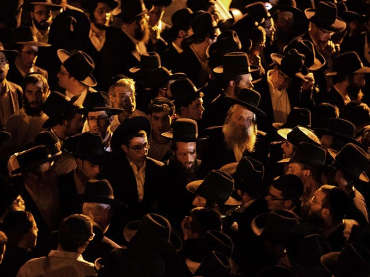 Ultra-orthodox Jewish mourners attend the funeral of three-month-old baby Chaya Zissel Braun in Jerusalem on October 23, 2014, after she was killed  when a Palestinian driver rammed a group of pedestrians.