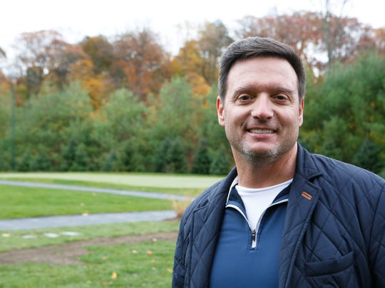Homeowner Mark Stagg's new private 3-acre golf course at his home in Purchase features three greens, four tees, sand traps, a fairway and night lighting, along with pond and 25-foot stone waterfall. Stagg is a builder and owner of a stone supply co. in Mount Kisco. The course was designed by Mark Lehrer of Home Green Advantage in Armonk. Homeowner Mark Stagg is photographed Nov. 7 in Purchase.