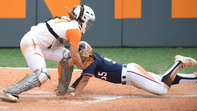 Tennessee's Abby Lockman (44) stops Arizona's Mandie Perez (55) short of stealing home plate during an NCAA softball tournament Knoxville Regional game at Sherri Parker Lee Stadium on Saturday, May 21, 2016. Arizona won 4-0. (ADAM LAU/NEWS SENTINEL)
