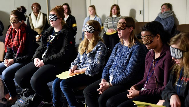 Participants experience being blind during an experiential learning scenario during the ABILITY event Tuesday, Feb. 27, at St. Cloud State University.