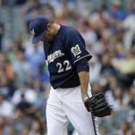 Milwaukee Brewers starting pitcher Matt Garza hangs his head after giving up a home run to the Minnesota Twins' Torii Hunter during the sixth inning of Saturday's game.