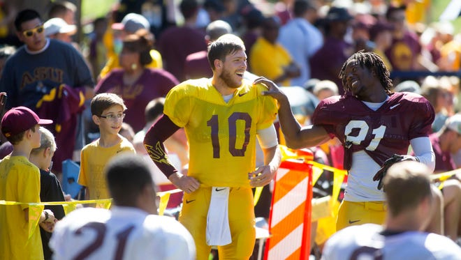 ASU quarterback Taylor Kelly jokes with #81 wide receiver Gary Chambers before an ASU football practice at Camp Tontozona on August 16, 2014.