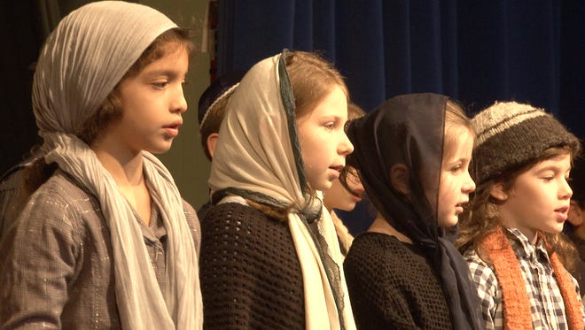Mia Ziv, Eliana Gillespie, Gavi Saks and Max Winaker sing during a performance of Hershel and the Hanukkah Goblins Wednesday morning at the Albert Einstein Academy in Talleyville.