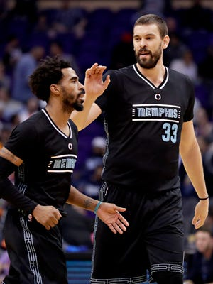 Memphis Grizzlies center Marc Gasol (33) congratulates guard Mike Conley during the second half of an NBA basketball game against the Phoenix Suns, Monday, Jan. 30, 2017, in Phoenix. (AP Photo/Matt York)