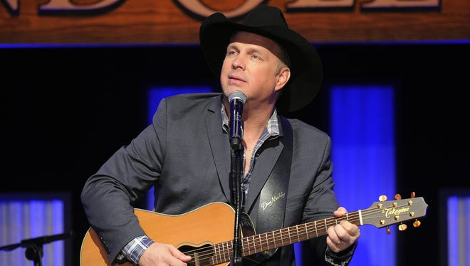 Garth Brooks performs during a salute to radio host Bob Kingsley on a program at the Grand Ole Opry House on Feb. 17, 2014.