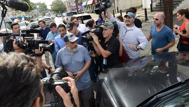 In this Sept. 20, 2016, file photo, Mohammad Rahami is surrounded by media outside his home in Elizabeth, N.J.