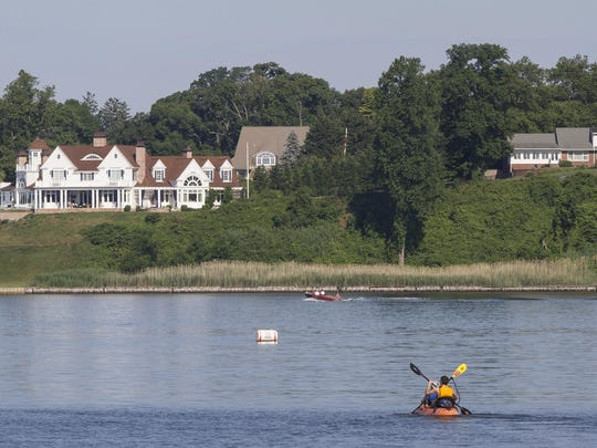 Asbury Park Press reporter Jerry Carino and Marlboro resident Mike Gasior head out onto the Navesink River for a tour of the area from Fair Haven.