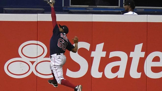 Red Sox left fielder Yairo Munoz catches a ball hit by the Marlins' Jazz Chisholm during the eighth inning of Tuesday night's game in Miami.