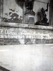 """Scrawled on the wall: """"I am ashamed I am a German,"""""""