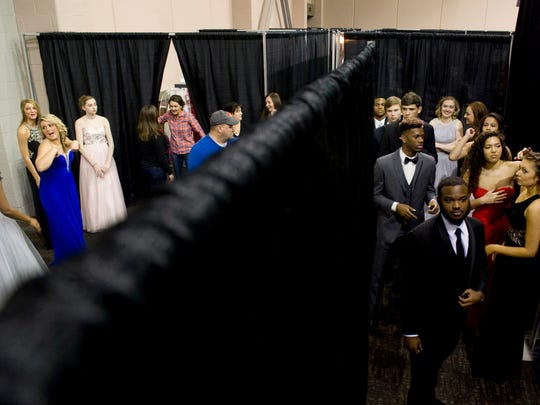 Models prepare to take the stage at the Wedding & Prom Showcase at the Old National Events Plaza last year.