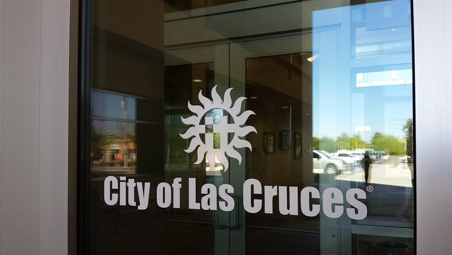 The city of Las Cruces logo is seen on a window at the entrance of city hall, 700 N. Main St., Las Cruces.